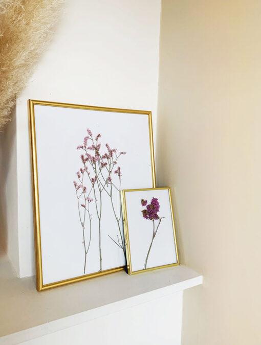 Smalle eenvoudige kunststof fotolijst in goud